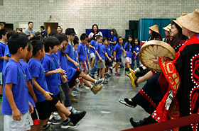 Students get to perform the traditional dance of the indigenous people of Alaska with the Alaska Native Heritage Center group.