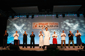 The participating chefs of Honolulu get up on stage to be introduced.