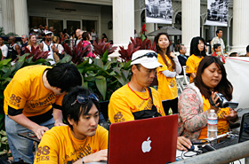 Students live streaming the Grand Parade in Waikiki.