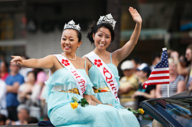 Miss Cherry Blossom's Queen and Princess, representing the Japanese American community of Hawaii, waved to the crowd.