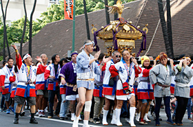 The Japanese Mikoshi carriers shouted in sync.