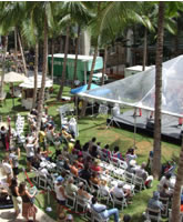The stage located at Waikiki Beach Walk is surrounded by Hawaii's blue skies and palm trees.