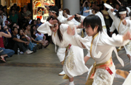 The performers dancing energetically right in front of the spectators, so close that you can hear them breathing