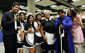 The maids of the Maid Cafe and guests  dressed in cosplay.