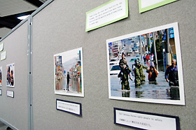 Pictures of the 2011 Tohoku Earthquake and Tsunami, exhibited by the Honolulu Consulate General of Japan, shared sights of people helping each other, supporting each other in order to live and survive.