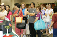 A line of attendees waiting to experience the art of ikebana