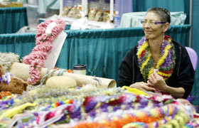 This Hawaii booth sold ribbon leis. The colorful ribbon leis were enjoyed by many visitors.
