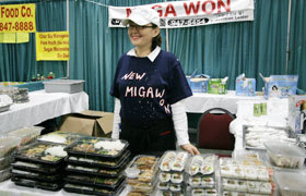 The Korean food booth Miga Won, their restaurant is right across the Hawaii Convention Center. Lots of bento!