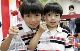 These brothers came to the goldfish scooping booth with their mom who is originally from Japan. They were happy to scoop up so many goldfish.