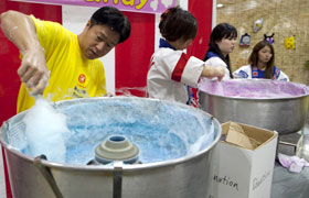 The staff work hard for the children. The cotton candy was once again popular this year.