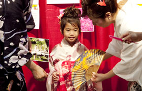 The little girl wears yukata and has her picture taken, creating a wonderful memory for her.