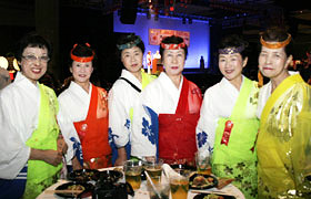 Members of the Luna Party from Kanagawa Prefecture's Hiratsuka Tanabata Matsuri dressed in their colorful costumes.