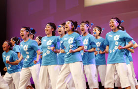 The Sonoda Gakuen High School girls brought energy and excitement to Hawaii. Their colorful costumes brightened the stage once again.