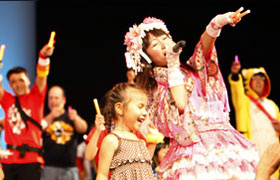 Children loved Momoi and got up on stage to dance with her and her Otaku fans.