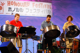 The Global Drums-Pangea from Canada excites the audience with their steel drum performance.