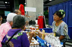 Many products made in Hawaii are sold at the Craft Fair. Taste testing is part of the fun.