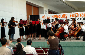 The students are members of the Kawananakoa Chamber Orchestra. Their beautiful music resonated throughout the Hawaii Convention Center.