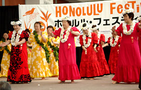 Aloha Diamonds dance in their colorful costumes.They always do much better dancing hula at the Honolulu Festival than at their practices!