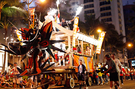 The fire bell heard throughout Waikiki announced the coming of Hawaii's own mikoshi, Honolulu Daijayama.