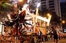 The fire bell heard throughout Waikiki announced the coming of Hawaii's own mikoshi, Honolulu Daijayama.