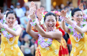 The ladies promote the city of Obama to the people of Hawaii with their smiles and hula.