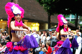 Members of Anela. Hula Studio. Their colorful costumes and rhythmical dancing made the rain disappear.
