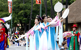 The dancers appear to be heavenly maidens in this traditional Korean dance.