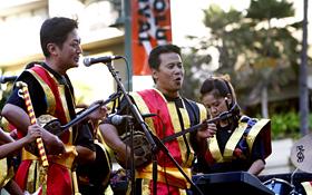 The Okinawa and Hawaii members of Ryukyu Koten Afuso-ryu OngakuKenkyuu Choichi Kai perform together.