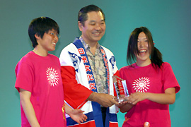 Award given to the girls by Mr. Sugi of the Honolulu Festival Foundation
