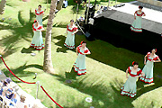 Hula dancers on the green lawn