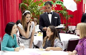 The maids took the order and cheerfully made conversation with the guests.