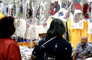 Da Bag Place, maker of bags and T-shirts out of traditional rice bag material.  T-shirts look comfortable to wear.