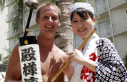 A Tonosama Ren awaodori dancer poses for a picture with a spectator. An example of friendship and goodwill.