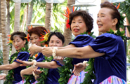 Kanagawa's Kaiulani Hula Community performs in their elegant costumes