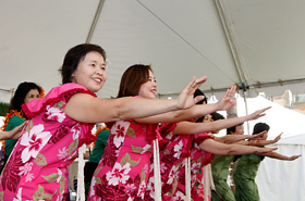 The members of Yutaka Hula Halau perform for the people of Hawaii with their beautiful smiles and graceful hula.